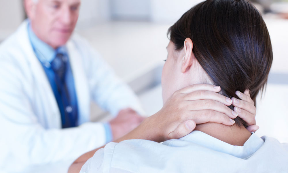 A lady suffering from nech pain having a consultaion with expert doctor