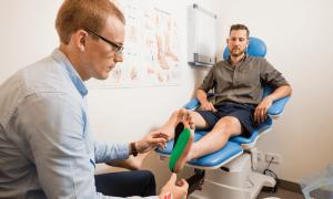 A gentleman having Podiatry process under his feet by MMB Podiatry expert