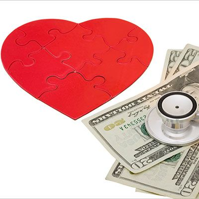 A heart puzzle and senthoscope on dollars currecy which represents cardiology medical billing