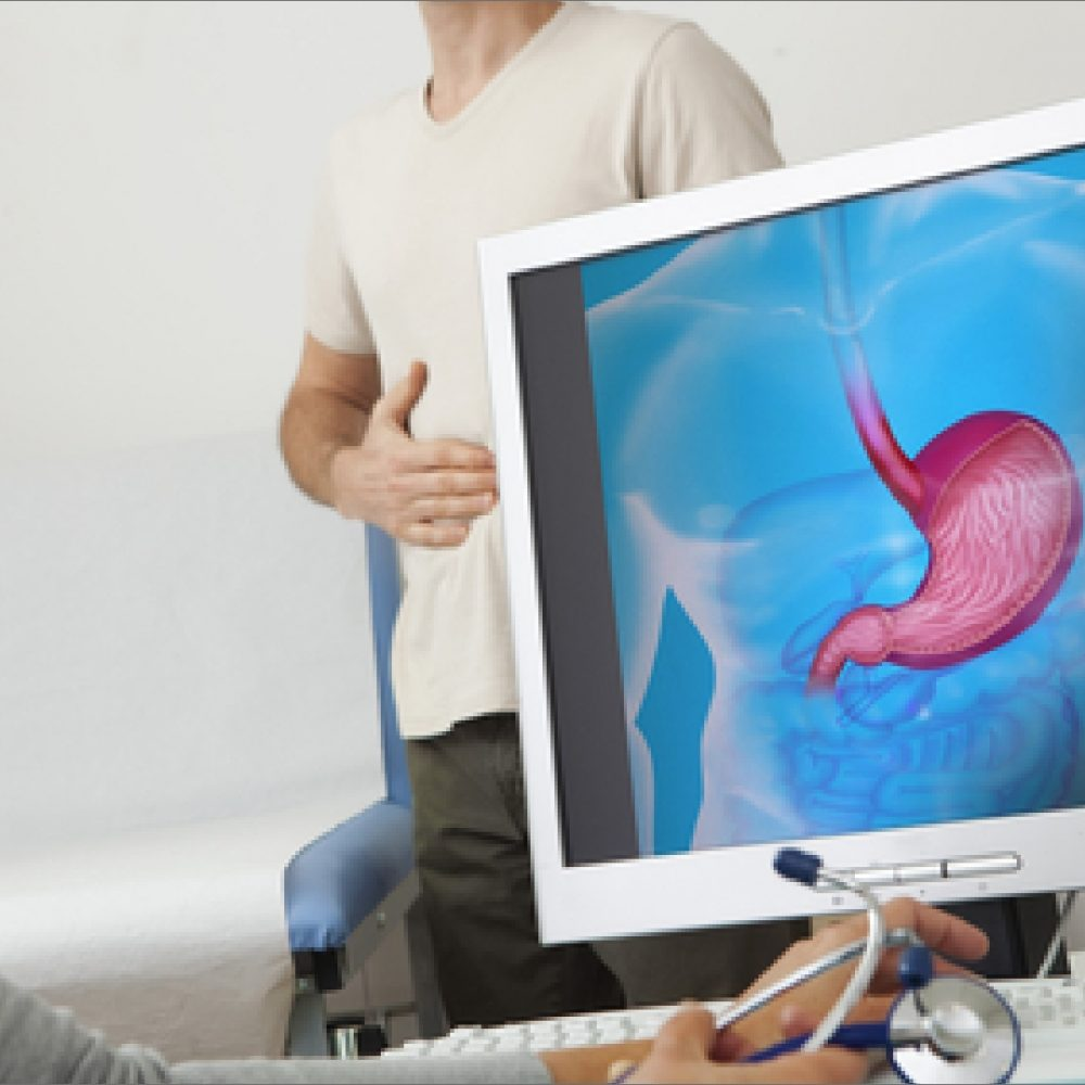 A gastronentrology patient having complete gastronentrology test and doctor examining the stomach in computer