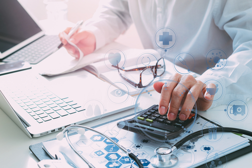 A billing expert is calculating and preparing the documentation for the client at millennuim medical billing