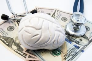 A model of a brain and a stratoscope is placed on $50 bills