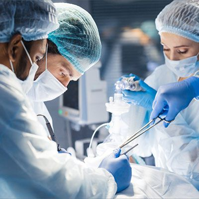 A team of surgeons doctors performing surgery on their patient